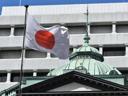 The Japanese national flag is seen at the Bank of Japan headquarters in Tokyo on March 16, 2020. - The Bank of Japan on March 16 unveiled a series of emergency monetary policy measures to shore up the world's third-largest economy, as the coronavirus pandemic threatens a global recession. (Photo …