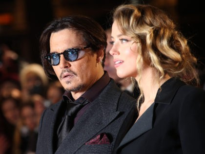 Actor Johnny Depp and Amber Heard pose for photographers upon arrival at the premiere of the film Mortdecai, in London, Monday, Jan. 19, 2015. (Photo by Joel Ryan/Invision/AP)