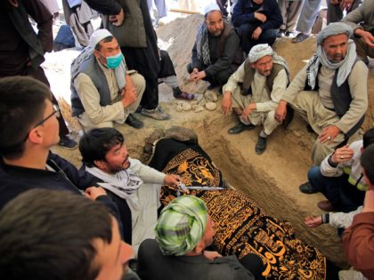 Afghan men bury a victim of deadly bombings on Saturday near a school, at a cemetary west of Kabul, Afghanistan, Sunday, May 9, 2021. The Interior Ministry said Sunday the death toll in the horrific bombing at the entrance to a girls' school in the Afghan capital has soared to …