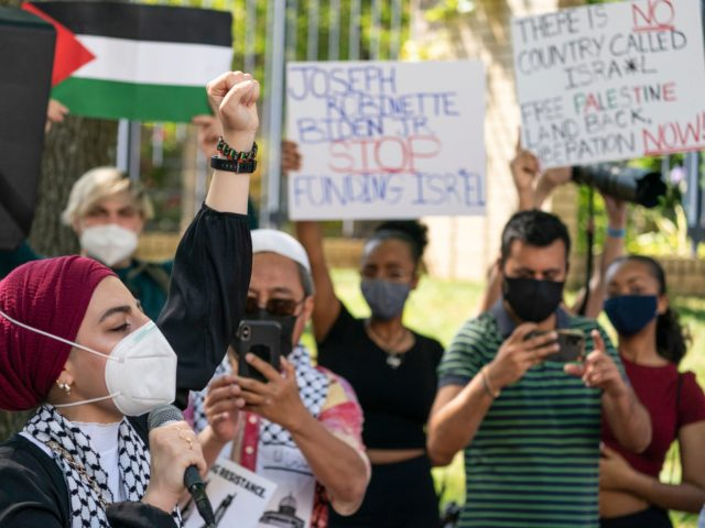 Protesters gather in front of the Israeli embassy to protest the Middle East war between Israelis and Palestinians, Tuesday, May 18, 2021, in Washington. (AP Photo/Alex Brandon)