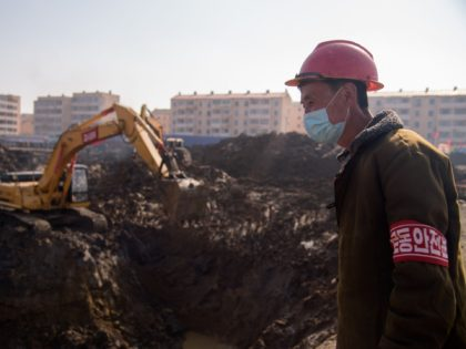 A worker at the construction site of a 10,000 apartment development in the Songsin and Songhwa area of Pyongyang on March 25, 2021. (Photo by KIM Won Jin / AFP) (Photo by KIM WON JIN/AFP via Getty Images)