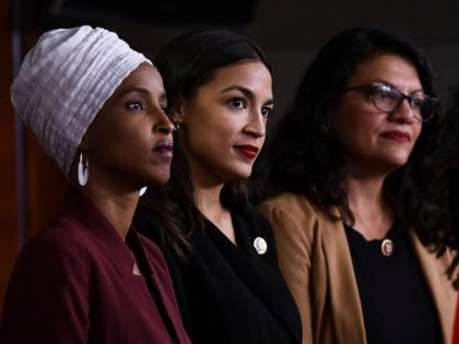 US Representatives Ayanna Pressley (D-MA) speaks as, Ilhan Abdullahi Omar (D-MN)(L), Rashida Tlaib (D-MI) (2R), and Alexandria Ocasio-Cortez (D-NY) hold a press conference, to address remarks made by US President Donald Trump earlier in the day, at the US Capitol in Washington, DC on July 15, 2019. - President Donald …