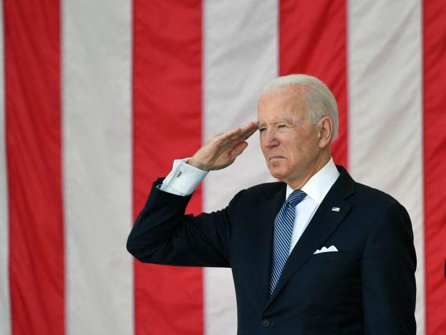 US President Joe Biden salutes at the 153rd National Memorial Day Observance at Arlington National Cemetery on Memorial Day in Arlington, Virginia on May 31, 2021. (Photo by MANDEL NGAN / AFP) (Photo by MANDEL NGAN/AFP via Getty Images)