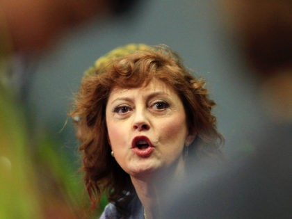 Actress Susan Sarandon cheers her team during a promotional table tennis event Saturday June 25, 2011 in Shanghai, China. (AP Photo/Eugene Hoshiko)