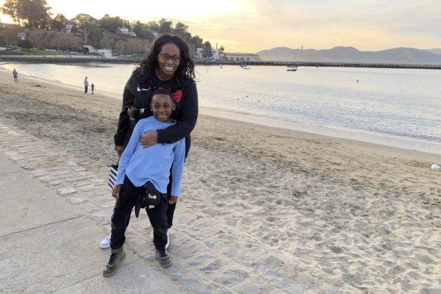 In this photo provided by Tanya Hayles, Hayles poses with her son Jackson, 7, in this undated photo. Hayles, founder of Black Moms Connection, an online network of more than 16,000 Black mothers with chapters across North America and Asia, said she has noticed discussions among members about how remote …
