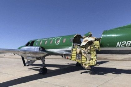 This image from CBS Denver shows a Key Lime Air Metroliner that landed safely at Centennial Airport after a mid-air collision near Denver on Wednesday, May 12, 2021. Federal officials say two airplanes collided but that there are no injuries. The collision between a twin-engine Fairchild Metroliner and a single-engine …