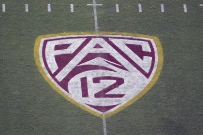 In this Aug. 29, 2019, file photo, the Pac-12 logo is displayed on the field at Sun Devil Stadium during an NCAA college football game between Arizona State and Kent State in Tempe, Ariz. The Pac-12 hired sports entertainment executive George Kliavkoff to be the conference's next commissioner on Thursday, …