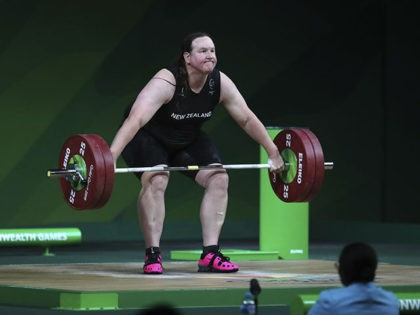 New Zealand's Laurel Hubbard lifts in the snatch of the women's +90kg weightlifting final at the 2018 Commonwealth Games on the Gold Coast, Australia, Monday, April 9, 2018. (AP Photo/Manish Swarup)