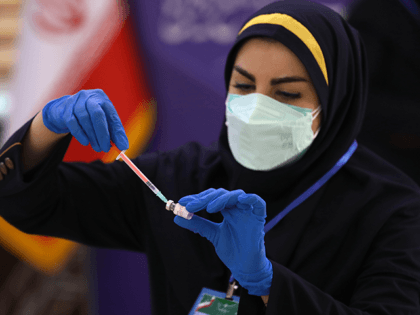 Medic Azin Chakeri prepares a Coviran Barekat Covid-19 vaccine to administer to volunteers during the third phase of the clinical trial of the Iranian developed vaccine, in a staged event at the Eram Grand Hotel in Tehran, Iran, Sunday, April 25, 2021. Shifa Pharmed is in the last stage of …