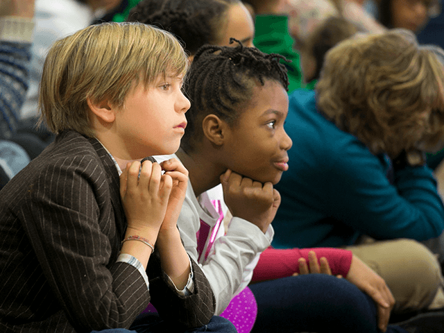 New York City school kids listen as Mayor-elect Bill de Blasio introduces the next schools chancellor, Carmen Farina, Monday, Dec. 30, 2013 at MS 51 in the Brooklyn borough of New York. Farina, a former teacher, principal and longtime advocate of early childhood education, will be the next leader of …