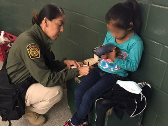 Border Patrol agents rescue a five-year-old girl after human smugglers abandoned her in a dangerous section of the California-Mexico border. (U.S. Border Patrol/San Diego Sector)
