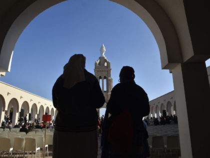 Nuns attend a ceremony at the Chapel of our Lady of Santa Cruz in Algeria's northern city of Oran, during which seven French monks and 12 other clergy killed during the country's civil war were beatified, on December 8, 2018. - Papal envoy Cardinal Angelo Becciu read the official decree …