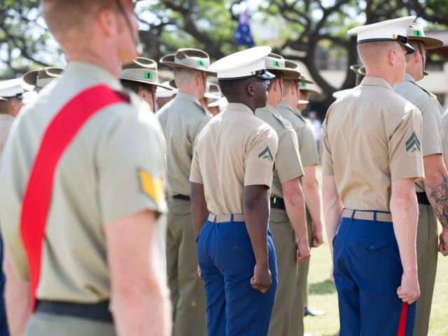 Australian Army soldiers and United States Marine Corps marines stand at attention during the Samichon Memorial Service on Exercise Rim of the Pacific 2016, Marine Corps Base Hawaii.