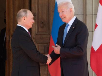 TOPSHOT - US President Joe Biden and Russian President Vladimir Putin shake hands as they arrive at Villa La Grange in Geneva, for the start of their summit on June 16, 2021. (Photo by SAUL LOEB / POOL / AFP) (Photo by SAUL LOEB/POOL/AFP via Getty Images)