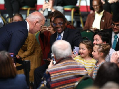 US President Joe Biden talks with children before delivering remarks to commemorate the 100th anniversary of the Tulsa Race Massacre at the Greenwood Cultural Center in Tulsa, Oklahoma on June 1, 2021. - US President Joe Biden traveled Tuesday to Oklahoma to honor the victims of a 1921 racial massacre …