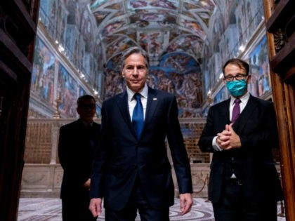 US Secretary of State Antony Blinken (C) and Charge d'Affaires of the US Embassy to the Holy See Patrick Connell (L) and tour guide Alessandro Conforti (R), leave the Sistine Chapel, in the Apostolic Palace, at the Vatican, ahead of a meeting with Pope Francis and Archbishop Paul Gallagher, as …