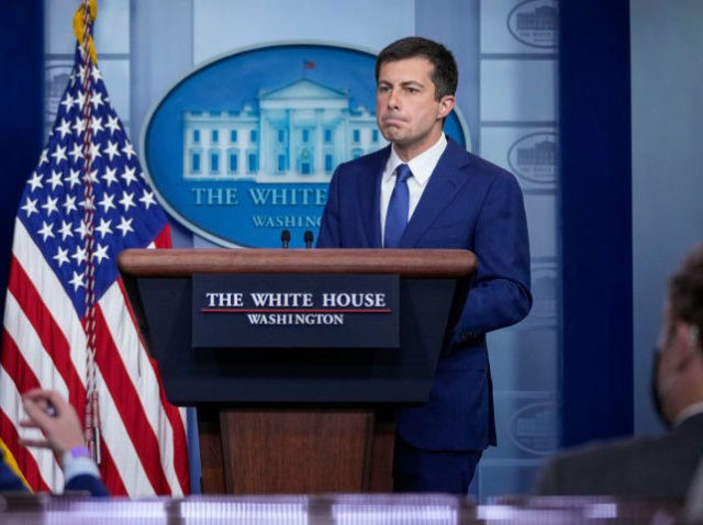 WASHINGTON, DC - MAY 12: (L-R) Administrator of the Environmental Protection Agency (EPA) Michael Regan and Secretary of Transportation Pete Buttigieg take questions during the daily press briefing at the White House on May 12, 2021 in Washington, DC. The majority of the briefing focused on the ransomwareattack on the …