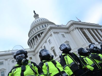 Police stand as supporters of US President Donald Trump protest outside the US Capitol on January 6, 2021, in Washington, DC. - Demonstrators breeched security and entered the Capitol as Congress debated the a 2020 presidential election Electoral Vote Certification. (Photo by Brendan SMIALOWSKI / AFP) (Photo by BRENDAN SMIALOWSKI/AFP …