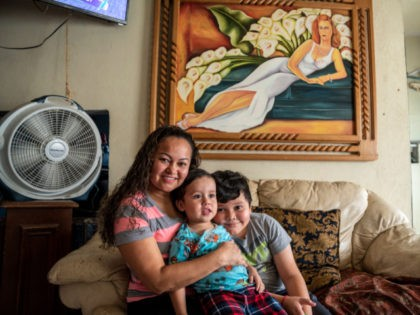 Alma Beatriz Serrano Ramirez (L) poses for a photo with her sons Adriel and Kennet at her home in Matamoros, Mexico on May 25, 2021. - Alma, a migrant from Honduras, would teach a weekend school at the migrant camp but after it was closed, the teachers wanting to continue …