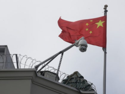 The flag of China flies behind a security camera over the Chinese Consulate in San Francisco, Thursday, July 23, 2020. The Chinese consulate in San Francisco is harboring a Chinese researcher who the FBI says lied about her military background. (AP Photo/Jeff Chiu)
