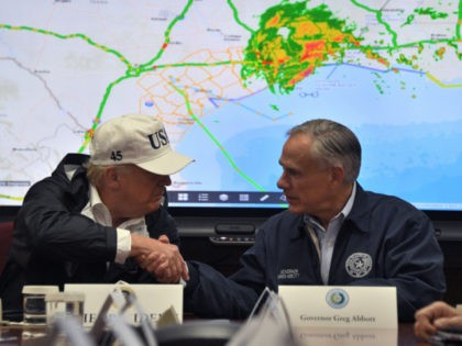 President Donald Trump shakes hands with Texas Governor Greg Abbott at the Texas Department of Public Safety Emergency Operations Center in Austin, Texas on August 29, 2017, as rains from Hurricane Harvey continue to flood parts of Texas. US President Donald Trump flew into storm-ravaged Texas Tuesday in a show …