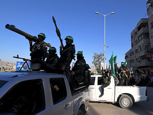 Members of the Ezzedine al-Qassam Brigades, the armed wing of the Palestinian Hamas movement, parade in Gaza City on june 7, 2021. (Photo by MOHAMMED ABED / AFP) (Photo by MOHAMMED ABED/AFP via Getty Images)