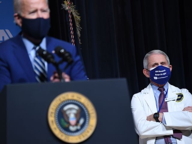 US President Joe Biden speaks, flanked by White House Chief Medical Adviser on Covid-19 Dr. Anthony Fauci (R), during a visit to the National Institutes of Health (NIH) in Bethesda, Maryland, February 11, 2021. (Photo by SAUL LOEB / AFP) (Photo by SAUL LOEB/AFP via Getty Images)