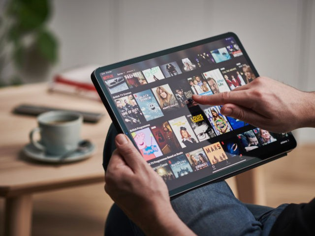 Detail of a mans hand scrolling through Netflix on an Apple iPad Pro, taken on March 6, 2020. (Photo by Phil Barker/Future Publishing via Getty Images)