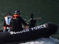 """UK Border Force officials escort migrants intercepted whilst travelling in a RIB from France to Dover ashore at the Marina in Dover, southeast England on August 13, 2020. - British Prime Minister Boris Johnson on Monday said illegal migrant crossings of the Channel, which have hit record numbers, were """"very …"""
