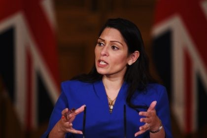 LONDON, ENGLAND - JANUARY 12: United Kingdom Home Secretary Priti Patel talks at a coronavirus press conference at Downing Street on January 12, 2021 in London, England. The Home Secretary pressed the message that the nation must abide by the government's rules to help get Covid-19 cases down again, following …