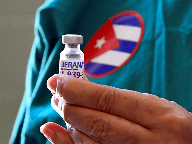 Nurse Xiomara Rodriguez shows a vial of the Cuban Soberana 2 vaccine candidate to be administered to a volunteer during its trial Phase III in Havana, on March 31, 2021. (Photo by Joaquin Hernandez / AFP) (Photo by JOAQUIN HERNANDEZ/AFP via Getty Images)