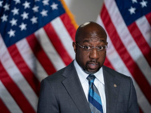WASHINGTON, DC - APRIL 20: Sen. Raphael Warnock (D-GA) (L) speaks during a news conference following the weekly Democrat policy luncheon on Capitol Hill on April 20, 2021 in Washington, DC. The Democratic Senators spoke about the COVID-19 Hate Crimes Act. (Photo by Sarah Silbiger/Getty Images)