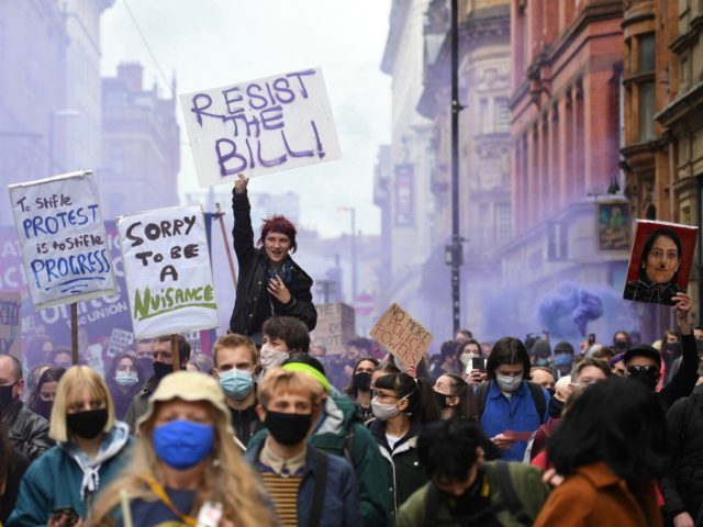 """Demonstrators protesting against the Police, Crime, Sentencing and Courts Bill 2021 march in central Manchester on May 1, 2021. - Previous """"Kill the Bill"""" demonstrations have turned violent, with protesters demanding the withdrawal of the legislation, which critics say harshly restricts the right to peaceful protest. (Photo by Oli SCARFF …"""