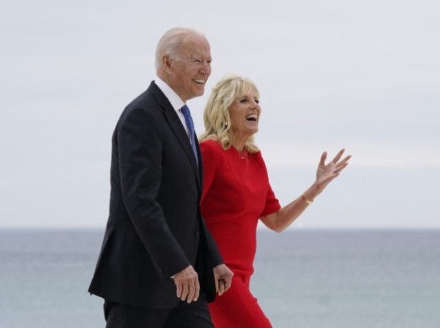 US President Joe Biden and US First Lady Jill Biden walk along the boardwalk at the start of the G7 summit in Carbis Bay, Cornwall on June 11, 2021. - G7 leaders from Canada, France, Germany, Italy, Japan, the UK and the United States meet this weekend for the first …