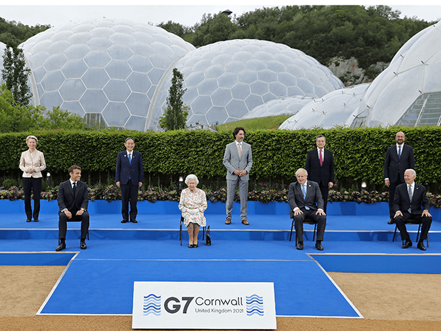 Britain's Queen Elizabeth II (C), poses for a family photograph with, from left, Germany's Chancellor Angela Merkel, President of the European Commission Ursula von der Leyen, France's President Emmanuel Macron, Japan's Prime Minister Yoshihide Suga, Canada's Prime Minister Justin Trudeau, Britain's Prime Minister Boris Johnson , Italy's Prime minister Mario …