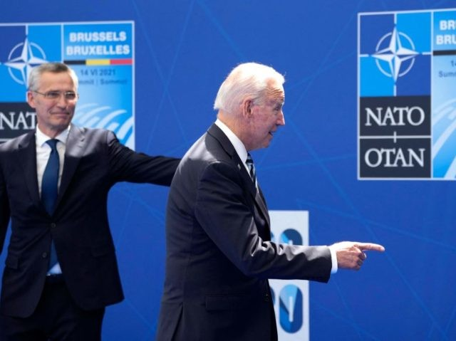 President Joe Biden (R) is greeted by NATO Secretary General Jens Stoltenberg at the NATO summit at NATO headquarters in Brussels, on June 14, 2021. - The 30-nation alliance hopes to reaffirm its unity and discuss increasingly tense relations with China and Russia, as the organization pulls its troops out …