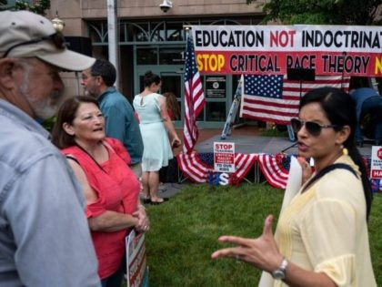 """People talk before the start of a rally against """"critical race theory"""" (CRT) being taught in schools at the Loudoun County Government center in Leesburg, Virginia on June 12, 2021. - """"Are you ready to take back our schools?"""" Republican activist Patti Menders shouted at a rally opposing anti-racism teaching …"""