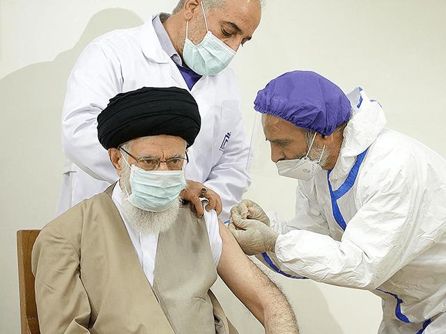 "Iran's Supreme Leader Ayatollah Ali Khamenei receives first dose of ""COVIRAN Bereket"" vaccine against coronavirus (Covid-19) in Tehran, Iran on June 25, 2021. (Photo by IRANIAN LEADER PRESS OFFICE/Anadolu Agency via Getty Images)"