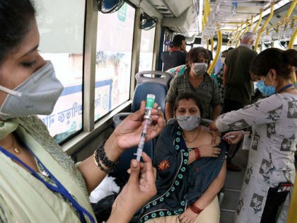 A health worker inoculates a women with a dose of the Covishield vaccine against the Covid-19 coronavirus at a vaccination on wheels in Kolkata On June 26,2021. Kolkata Municipal Corporation (KMC) An air-conditioned bus was provided by the West Bengal goverment Transport Department for vaccinating priority groups at the different …