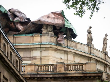 29 June 2021, Baden-Wuerttemberg, Stuttgart: Parts of the roof of the opera house have been severely damaged by a storm. A strong thunderstorm had swept across large parts of Baden-Württemberg, causing extensive damage. Photo: Christoph Schmidt/dpa (Photo by Christoph Schmidt/picture alliance via Getty Images)