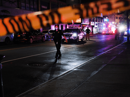 Police gather at the scene where two New York City police officers were shot in a confrontation late Wednesday evening in Brooklyn on June 03, 2020 in New York City. The officers were hit by gunfire in the Flatbush section of Brooklyn just before midnight and no details have yet …