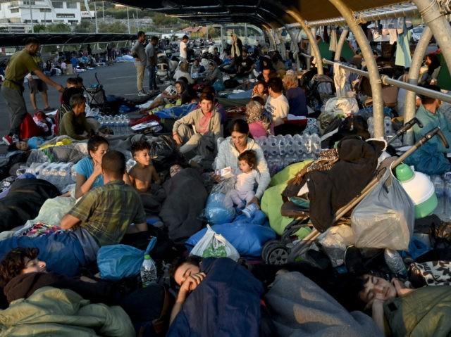 MYTILENE, GREECE - SEPTEMBER 10: Refugees find shelter outside Lidl supermarket next to road close to Mytilene town, after a fire destroyed Moria Refugee Camp on the island of Lesbos, on September 11, 2020 in Mytilene, Greece. A massive fire ravaged the island's main migrant camp on Tuesday night leaving …