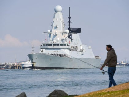 PORTSMOUTH, ENGLAND - MAY 01: HMS Defender leaves Portsmouth on May 01, 2021 in Portsmouth, United Kingdom. The UK's Carrier Strike Group, led by aircraft carrier HMS Queen Elizabeth, will visit more than one fifth of the world's nations during the deployment. The task group will visit 40 nations covering …