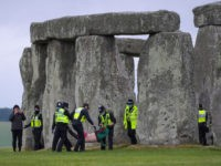 Oi! Where's Your Being Outside Licence? Police Break Up Midsummer Celebration at England's Ancient Stonehenge