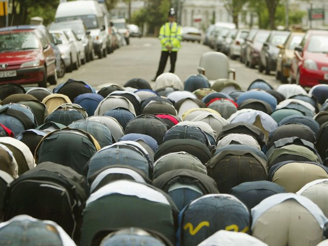 LONDON, ENGLAND - MAY 27: A British police officer watches as followers of radical muslim cleric Abu Hamza al-Masri gather for Friday prayers on May 28, 2004 outside the Finsbury Park mosque in north London, England. Abu Hamza al-Masri was arrested yesterday and remanded in custody pending hearings into his …