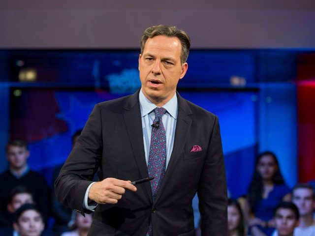 """CAMBRIDGE, MA - DECEMBER 01: Jake Tapper, of CNN's State of the Union, speaks to a crowd at the Harvard Institute of Politics Forum before Trump Campaign Manager Kellyanne Conway and Clinton Campaign Manager Robby Mook enter the room for an event titled """"War Stories: Inside Campaign 2016"""" on December …"""