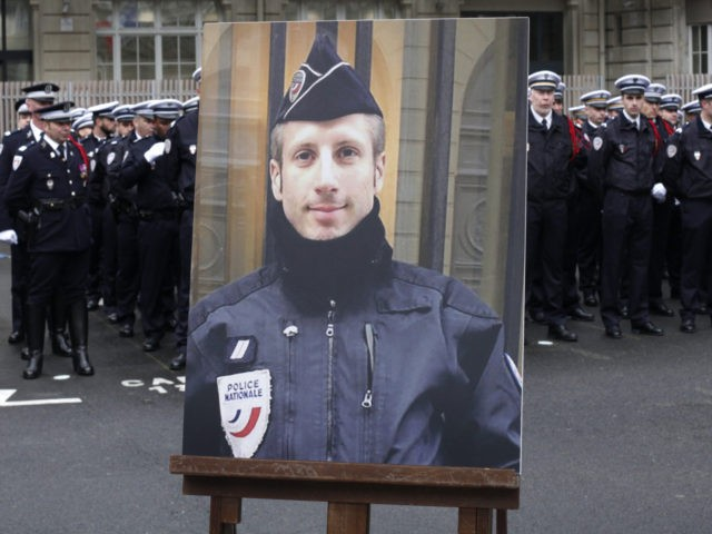 A portrait of Xavier Jugele, the policeman killed by a jihadist in an attack on the Champs Elysees, is pictured during a ceremony on April 25, 2017 at the Paris prefecture building. French police officer Xavier Jugele was killed on the world-famous Paris avenue on April 20, in an attack …