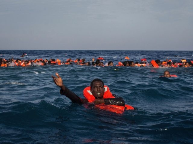 LAMPEDUSA, ITALY - MAY 24: Refugees and migrants are seen swimming and yelling for assistance from crew members from the Migrant Offshore Aid Station (MOAS) 'Phoenix' vessel after a wooden boat bound for Italy carrying more than 500 people capsized on May 24, 2017 off Lampedusa, Italy. Numbers of refugees …