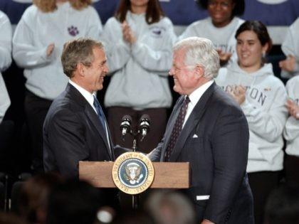 """399370 04: US President George W. Bush (L) shakes hands with US Senator Edward M. Kennedy (D-MA) January 8, 2001 at Boston Latin School in Boston, MA. Bush spoke about his """"No Child Left Behind"""" education bill which is the centerpiece of his domestic policy agenda. (Photo by Darren McCollester/Getty …"""