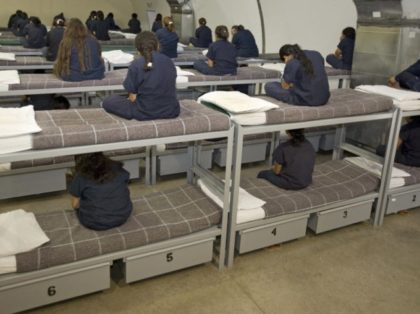 Raymondville, UNITED STATES: Female detainees turn their backs to the visiting media as instructed by Homeland Security officials inside Homeland Security's Willacy Detention Center, a facility with 10 giant tents that can house up to 2000 detained illegal immigrants, 10 May 2007 in Raymondville, Texas. The 65 million USD facility …